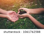 hand for planting trees back to ... | Shutterstock . vector #1061762588