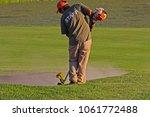 a golf course maintenance... | Shutterstock . vector #1061772488