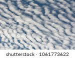 Small photo of White altocumulus (middle-altitude) clouds in a blue sky