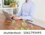 asian man using laptop  hands | Shutterstock . vector #1061795495
