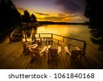 adirondack chairs sitting on a... | Shutterstock . vector #1061840168