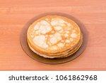 a glass plate of blini  ... | Shutterstock . vector #1061862968