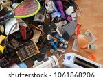 pile of used electronic and... | Shutterstock . vector #1061868206