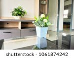 flowerpot on table in living... | Shutterstock . vector #1061874242