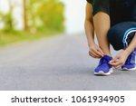 girl runner trying running... | Shutterstock . vector #1061934905
