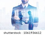 businesspeople on abstract... | Shutterstock . vector #1061936612