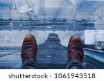 standing on glass floor on edge ... | Shutterstock . vector #1061943518