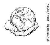 human hand holding globe. earth ... | Shutterstock .eps vector #1061945462