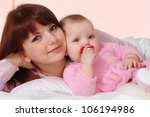 a beautiful mom with her... | Shutterstock . vector #106194986