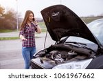 young worried girl is using a... | Shutterstock . vector #1061967662