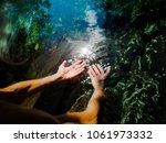 spiritual woman is touching... | Shutterstock . vector #1061973332