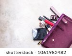 open purple woman's purse with... | Shutterstock . vector #1061982482