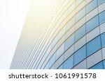 curved facade of modern glass... | Shutterstock . vector #1061991578
