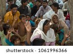 Small photo of LAHORE, PAKISTAN- AUG 2: Unidentified children and women as a slavery in brick kiln, are waiting for the food from relief team on August 2 2012 in Lahore, Pakistan.