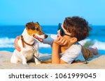 happy 8 year old boy hugging... | Shutterstock . vector #1061999045