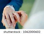 ring wedding ceremony | Shutterstock . vector #1062000602