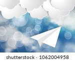 white paper aplane with blue... | Shutterstock .eps vector #1062004958