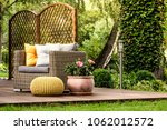 yellow pouf next to a rattan... | Shutterstock . vector #1062012572