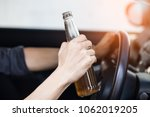 close up of driver and drinking ... | Shutterstock . vector #1062019205