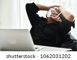 stressed young asian... | Shutterstock . vector #1062031202