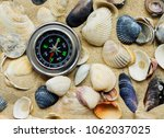 magnetic compass on sand and... | Shutterstock . vector #1062037025