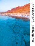 salt on the shore of the dead... | Shutterstock . vector #1062045506