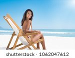beautiful woman sitting on a...   Shutterstock . vector #1062047612