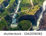 victoria falls on the zambezi... | Shutterstock . vector #1062058382