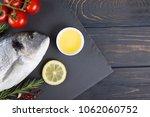 raw fish dorado cooking and... | Shutterstock . vector #1062060752