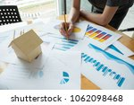 business person analyzing... | Shutterstock . vector #1062098468