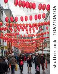 Small photo of London, United Kingdom – March 6 2018: People walking in the streets of the famous China town dressed with red balloons at the city of London in United Kingdom.