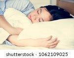 a woman sleeping | Shutterstock . vector #1062109025