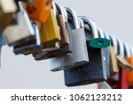 lot of padlocks hanging on... | Shutterstock . vector #1062123212