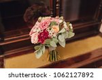 a bouquet of flowers and greens ... | Shutterstock . vector #1062127892