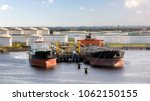 oil tankers moored at an... | Shutterstock . vector #1062150155