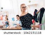 three girls at garment factory. ... | Shutterstock . vector #1062151118