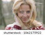 blonde woman portrait outdoor.... | Shutterstock . vector #1062175922