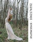 bride standing in forest | Shutterstock . vector #1062176552