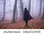 Girl In Black Hood Standing On...