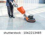 cleaning floor with machine | Shutterstock . vector #1062213485