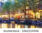 canals of amsterdam. moody... | Shutterstock . vector #1062214346