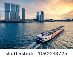 Small photo of ROTTERDAM, HOLLAND - FEBRUARY 10 2018: View on the river Maas, Rotterdam. Color shift by intent