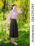 beautiful romantic girl dressed ... | Shutterstock . vector #1062291395