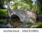stone bridge spanning a small... | Shutterstock . vector #1062313802