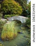stone bridge over a creek in a... | Shutterstock . vector #1062314456