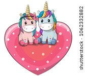 two cute cartoon unicorns are ... | Shutterstock .eps vector #1062332882