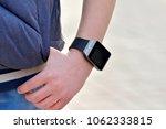 a smart watch on the boy's hand ... | Shutterstock . vector #1062333815