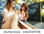 two female friends hangout at... | Shutterstock . vector #1062335558