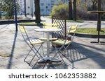 yellow bistro chairs or garden... | Shutterstock . vector #1062353882
