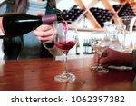 sommelier of the tasting room... | Shutterstock . vector #1062397382